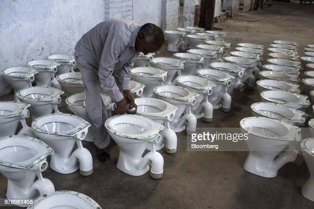 Super Worlds Best Toilet Manufacturing At A Hsil Ltd Plant Stock Gmtry Best Dining Table And Chair Ideas Images Gmtryco
