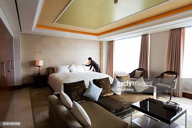 An employee arranges a bed inside a royal suite room at the Hotel Lotte Co Seoul hotel in South Korea on Thursday Feb 4 2016 Hotel Lotte the lodgings...