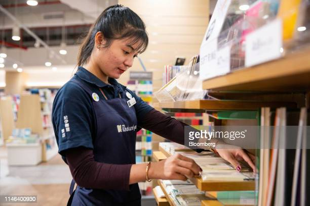 An employee arranges a display in the stationary section of the Kinokuniya Co book store at the Aeon Mall in Phnom Penh Cambodia Sunday May 26 2019...