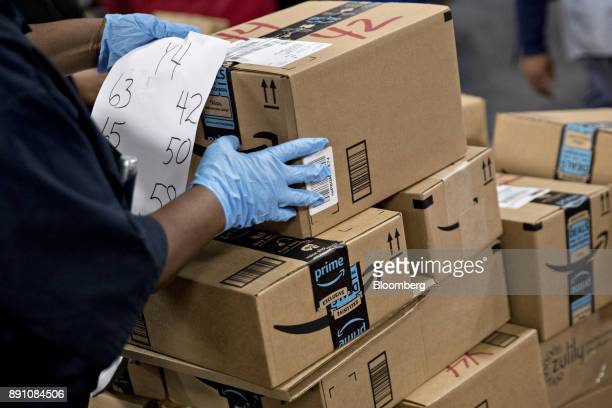 An employee arranges Amazoncom Inc packages before delivery at the United States Postal Service Joseph Curseen Jr and Thomas Morris Jr processing and...