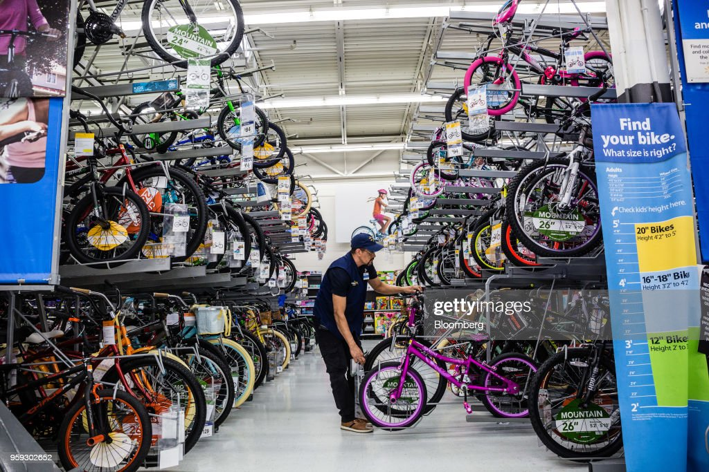 An employee arranges bicycles at a Walmart Inc. store in Secaucus, New Jersey, U.S., on Wednesday, May 16, 2018. Walmart is scheduled to release earnings figures on May 17. Photographer: Timothy Fadek/Bloomberg via Getty Images