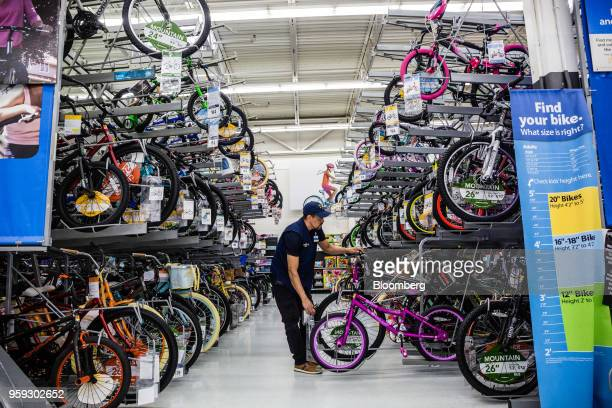 An employee arranges bicycles at a Walmart Inc store in Secaucus New Jersey US on Wednesday May 16 2018 Walmart is scheduled to release earnings...