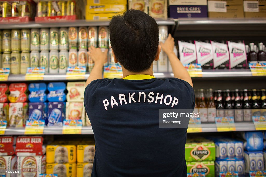 An employee arranges cans of beer on a shelf at a ParknShop Superstore supermarket, operated by Hutchison Whampoa Ltd., in Hong Kong, China, on Thursday, Aug. 1, 2013. KKR & Co., the private-equity firm run by Henry Kravis and George Roberts, is evaluating a bid for Hong Kong supermarket chain ParknShop, according to two people with knowledge of the matter. Hutchison is seeking $3 billion to $4 billion for the chain and has asked potential buyers to submit bids by Aug. 16, people with knowledge of the process have said. Photographer: Lam Yik Fei/Bloomberg via Getty Images