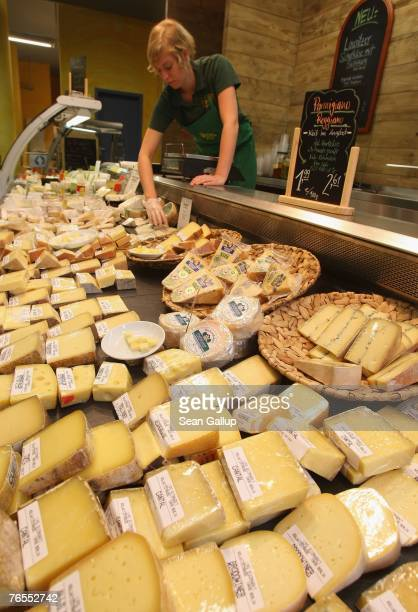 An employee arranges cheeses at the LPG Bio supermarket in the district of Prenzlauerberg September 6 2007 in Berlin Germany Germanys association of...