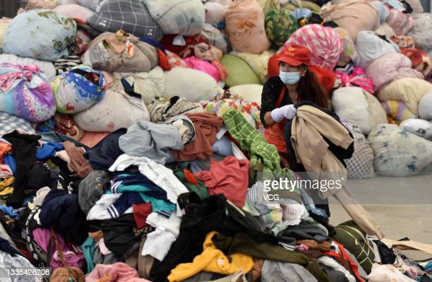 An employee arranges clothes at a waste sorting centre on August 21, 2021 in Taiyuan, Shanxi Province of China.