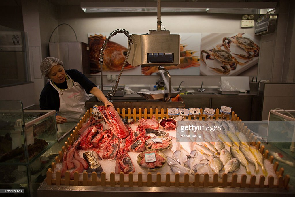 An employee arranges fish at a ParknShop Superstore supermarket, operated by Hutchison Whampoa Ltd., in Hong Kong, China, on Thursday, Aug. 1, 2013. KKR & Co., the private-equity firm run by Henry Kravis and George Roberts, is evaluating a bid for Hong Kong supermarket chain ParknShop, according to two people with knowledge of the matter. Hutchison is seeking $3 billion to $4 billion for the chain and has asked potential buyers to submit bids by Aug. 16, people with knowledge of the process have said. Photographer: Lam Yik Fei/Bloomberg via Getty Images