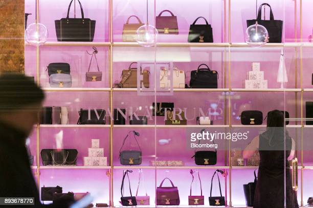 An employee arranges handbags on display inside an Ivanka Trump brand store at Trump Tower in New York US on Thursday Dec 14 2017 Trump's new store...