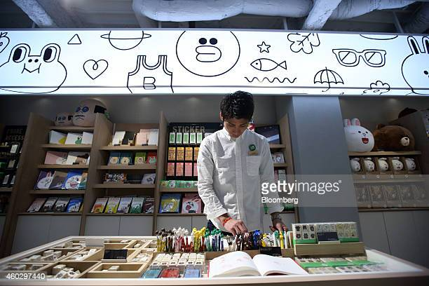 An employee arranges Line Corp character merchandise at the Line Friends Store in Tokyo Japan on Thursday Dec 10 2014 Line which makes money by...