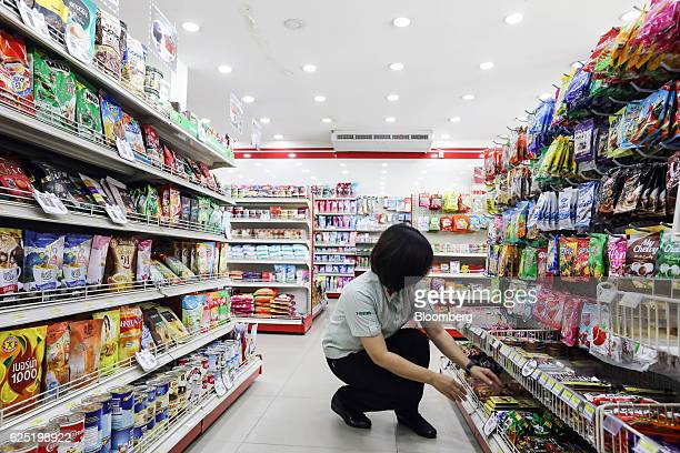 An employee arranges merchandise at a 7Eleven convenience store managed by Yingyong Minimart Ltd in Ubon Ratchathani Thailand on Wednesday Nov 9 2016...