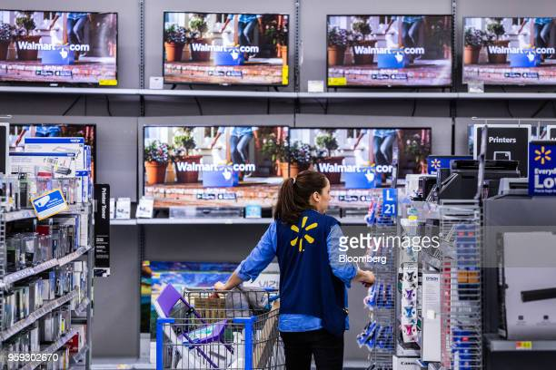 An employee arranges merchandise at a Walmart Inc store in Secaucus New Jersey US on Wednesday May 16 2018 Walmart is scheduled to release earnings...