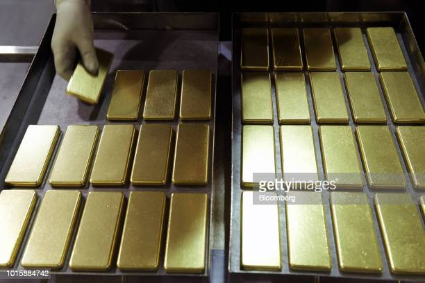 An employee arranges one kilogram gold bars at the Perth Mint Refinery operated by Gold Corp in Perth Australia on Thursday Aug 9 2018 Demand for...
