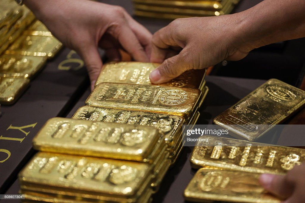 An employee arranges one kilogram gold bars for a photograph at the YLG Bullion International Co. headquarters in Bangkok, Thailand, on Wednesday, Jan. 13, 2016. Thailand's biggest buyer of gold will boost purchases by about 25 percent to 160 tons this year, said chief executive officer Pawan Nawawattanasub. Photographer: Dario Pignatelli/Bloomberg via Getty Images