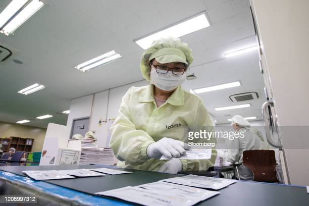 An employee arranges packages of the Ichroma Covid19 Ab testing kit at the Boditech Med Inc headquarters in Chuncheon South Korea on Friday April 3...