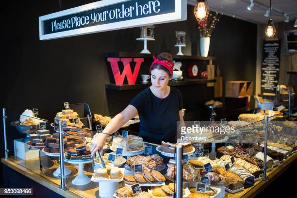 An employee arranges pastries at a Purebread bakery in Whistler British Columbia Canada on Friday April 27 2018 The cost of a typical home in...