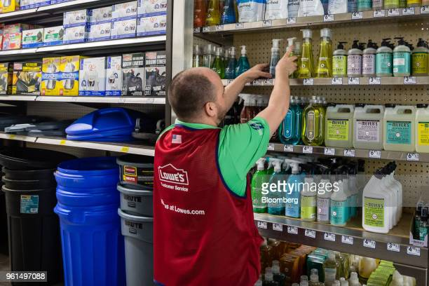 An employee arranges soap bottles on display for sale at a Lowe's Cos store in New York US on Tuesday May 22 2018 Lowe's Cos is scheduled to release...