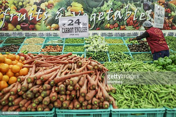 An employee arranges vegetables at a DMart supermarket operated by Avenue Supermarts Ltd in Thane Maharashtra India on Saturday Feb 13 2016 India's...