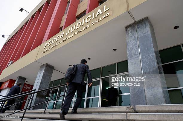 An employee arrives at the Courthouse of Callao where 19yearold Briton Melissa Reid and 20yearold Irishwoman Michaella McCollum Connolly appeared on...