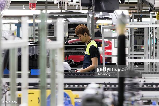 An employee assembles a Hyundai Motor Co. Elantra vehicle on the production line at the company's plant in Ulsan, South Korea, on Monday, July 4,...