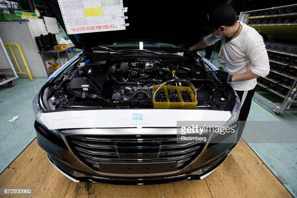 An employee assembles a Hyundai Motor Co. Genesis luxury sedan on the production line at the company's plant in Ulsan, South Korea, on Monday, April...