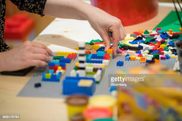 An employee assembles a model with Lego A/S toy bricks in a rest area during the opening of the Robert Bosch GmbH Internet of Things campus in Berlin...