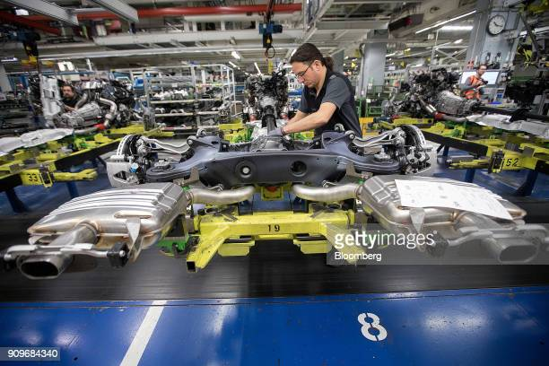 An employee assembles a powertrain system on the MercedesBenz SClass automobile production line at the automaker's factory in Sindelfingen Germany on...