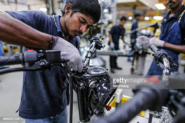 An employee assembles a Royal Enfield Motors Ltd Classic 350 motorcycle on the production line at the company's manufacturing facility in Chennai...