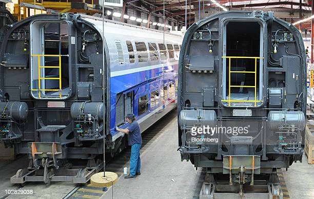 An employee assembles a TGV train at the Alstom SA factory in Aytre France on Monday July 12 2010 Alstom SA won a 33 millioneuro contract to design...
