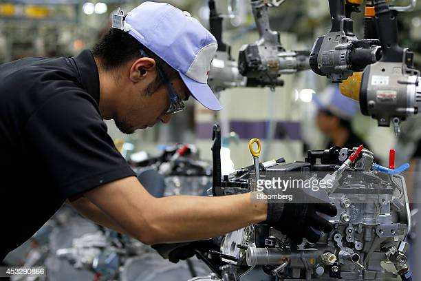 An employee assembles an 8ARFTS turbo engine for Toyota Motor Corp's Lexus NX crossover sportutility vehicle on the production line at the Toyota...