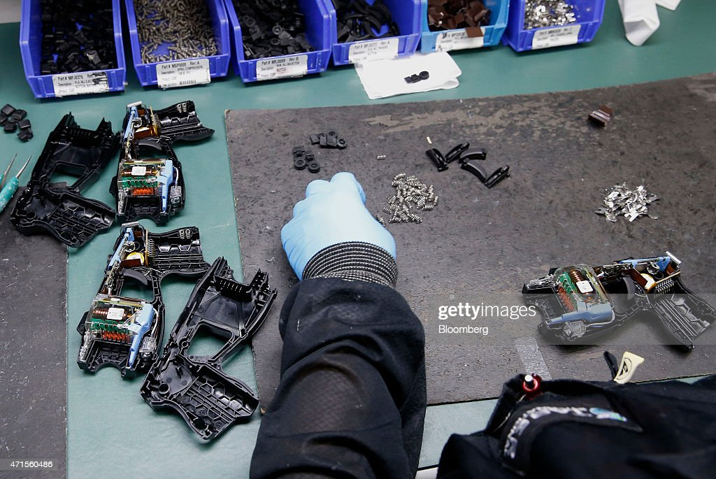 An employee assembles Taser X26 electronic weapons at the