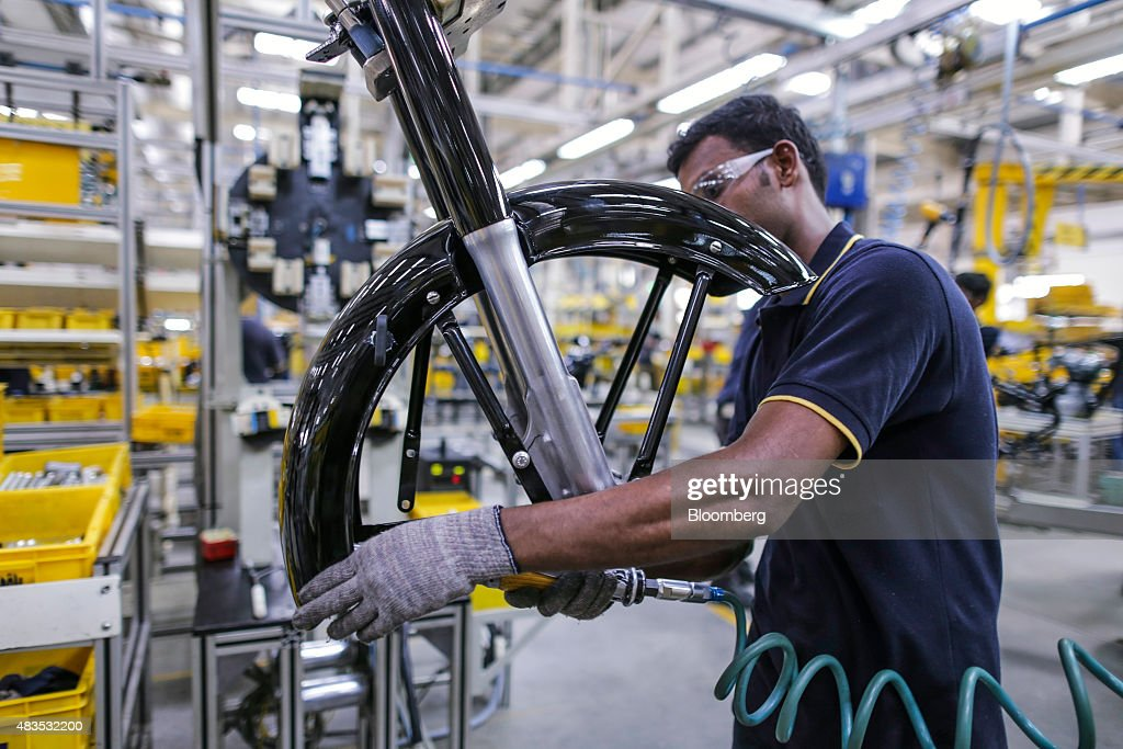 An employee assembles the front fender of a Royal Enfield Motors Ltd Classic 350 motorcycle on the production line at the company`s manufacturing...