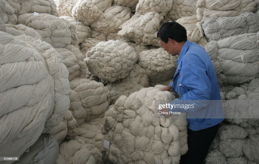 An employee at a Qinghai Tibetan Sheep Carpets (Group) Ltd. factory picks yarn to produce carpet April 4, 2005 in Xining, Qinghai Province, northwest China. Qinghai Tibetan Sheep Carpets is a famous import and export enterprise in China's west region, with its traditional Tibetan carpets exported to more than 24 countries and regions in Europe, Asia and the U.S. The Chinese government is seeking ways to boost development of the west region, as economic growth of eight percent has been forcast for this year.