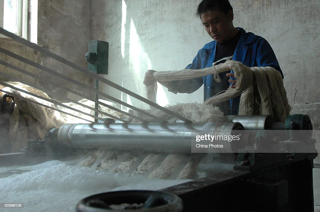 An employee at a Qinghai Tibetan Sheep Carpets (Group) Ltd. factory works with yarns to produce carpet April 4, 2005 in Xining, Qinghai Province, northwest China. Qinghai Tibetan Sheep Carpets is a famous import and export enterprise in China's west region, with its traditional Tibetan carpets exported to more than 24 countries and regions in Europe, Asia and the U.S. The Chinese government is seeking ways to boost development of the west region, as economic growth of eight percent has been forcast for this year.