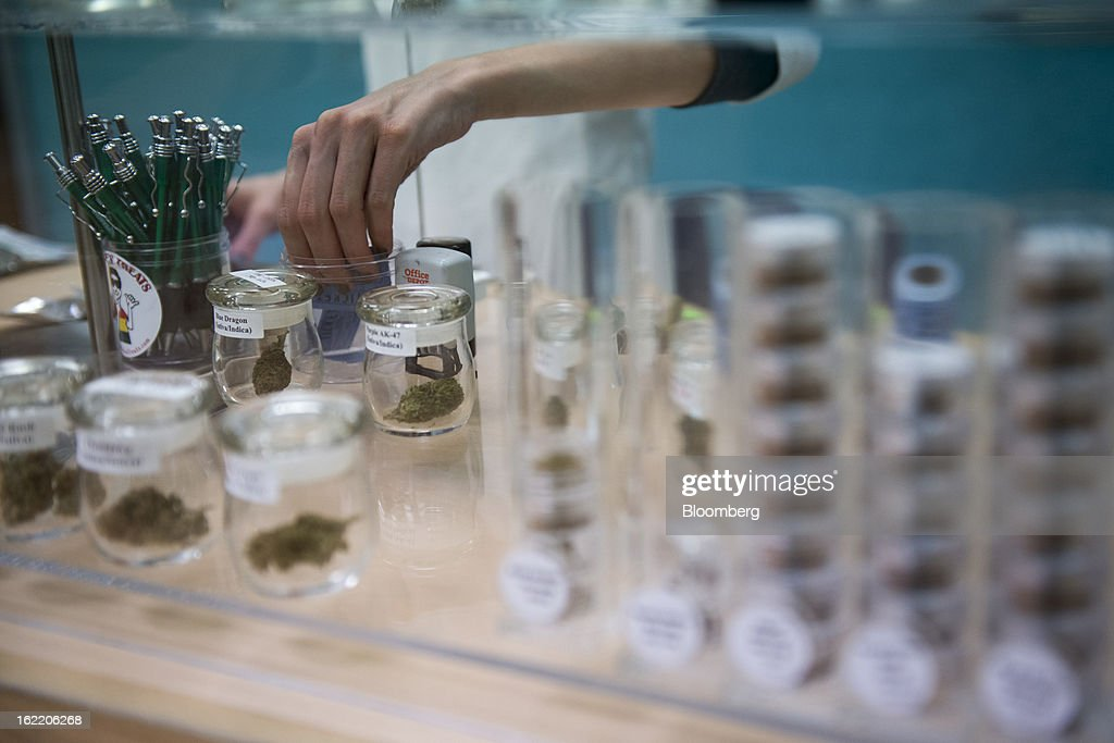 An employee at ARC Healing Center picks out a medical-marijuana bud for a customer in San Jose, California, U.S., on Thursday, Feb. 7, 2013. San Jose is the medical-marijuana capital of Silicon Valley with 106 clinics, about twice as many per square mile as Los Angeles. Photographer: David Paul Morris/Bloomberg via Getty Images