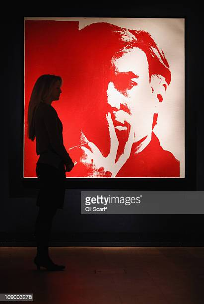 An employee at Christie's auction house views a selfportrait painting by Andy Warhol on February 11 2011 in London England The giant selfportrait...
