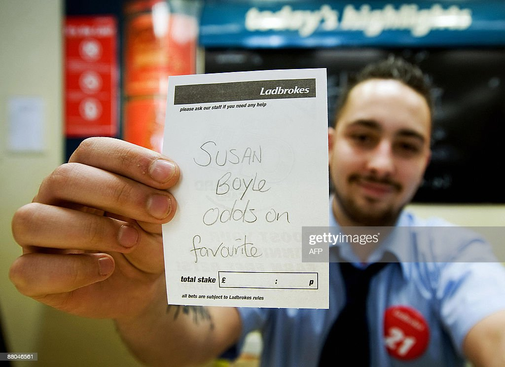 An employee at Ladbrokes bookmakers in B : News Photo