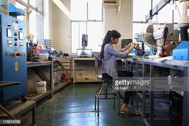 ce76c94bed8 An employee at Savile Row creates a pair of spectacles in their factory in  Stratford on