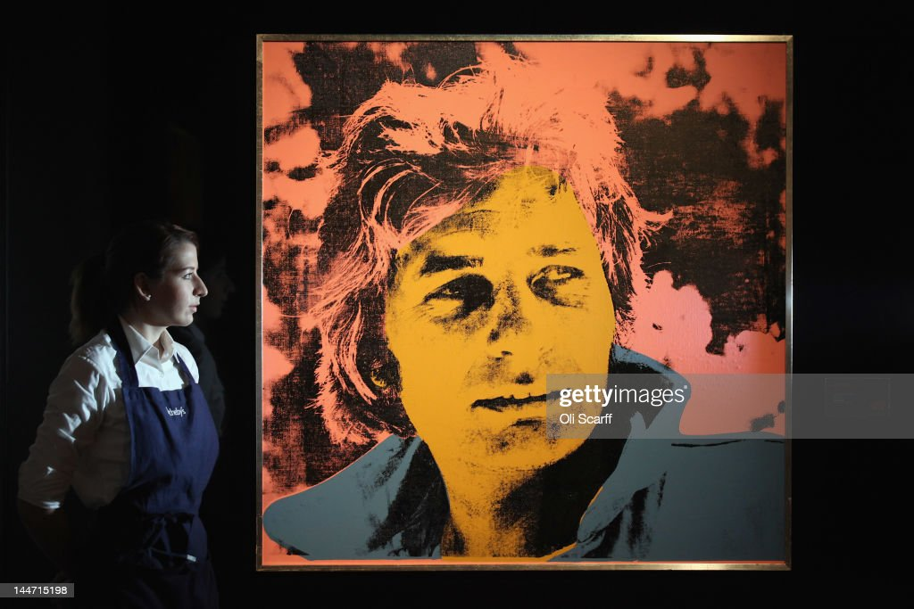 An employee at Sotheby's auction house views an artwork by Andy Warhol entitled 'Gunter Sachs' which is expected to fetch 600,000 GBP on May 18, 2012 in London, England. The artwork features in Sotheby's forthcoming sale from the collection of Gunter Sachs which is to be held on May 22 and 23, 2012 in London. The collection of over 300 works owned by the late husband of Brigitte Bardot is expected to fetch in excess of 20 million GBP.
