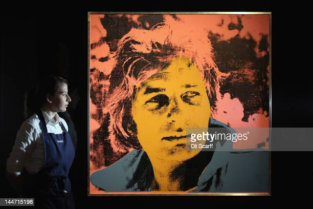 An employee at Sotheby's auction house views an artwork by Andy Warhol entitled 'Gunter Sachs' which is expected to fetch 600000 GBP on May 18 2012...
