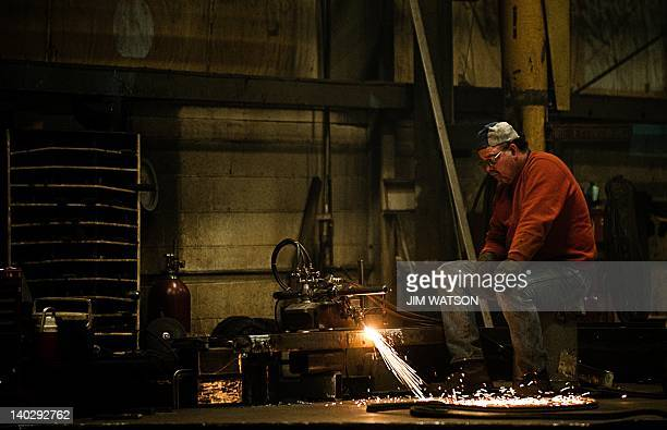 An employee at Specialty Fab in North Lima Ohio works on a piece of a compressor skid frame on March 1 which is bound for the Ohio Shale project...