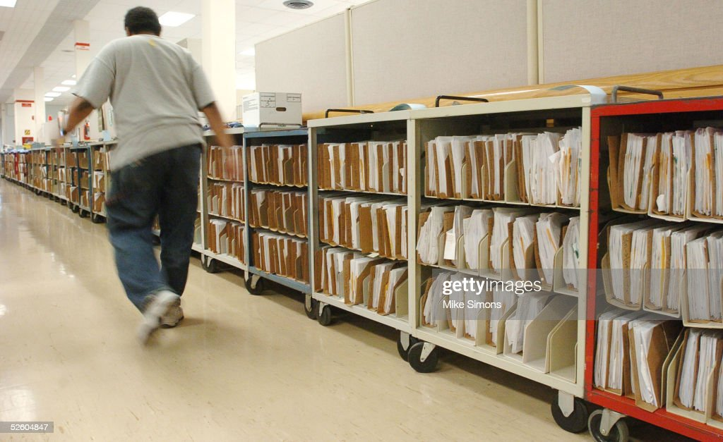 An employee at the Cincinnati Internal Revenue Service Center makes their way past the returns waiting to be processed April 8, 2005 in Covington, Kentucky. The tax filing deadline is a week away.