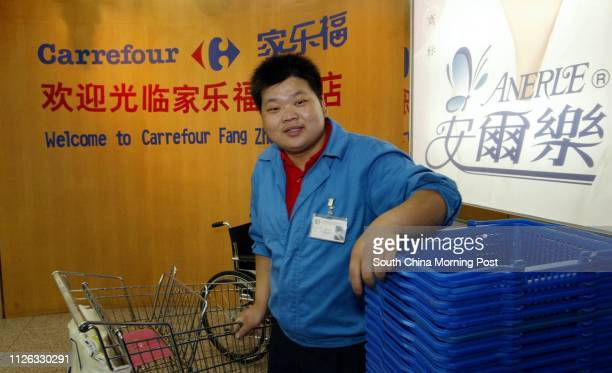 An employee at the French owned Carrefour Department store in Beijing China The store has 3 branches in the city and has recently been involved in a...