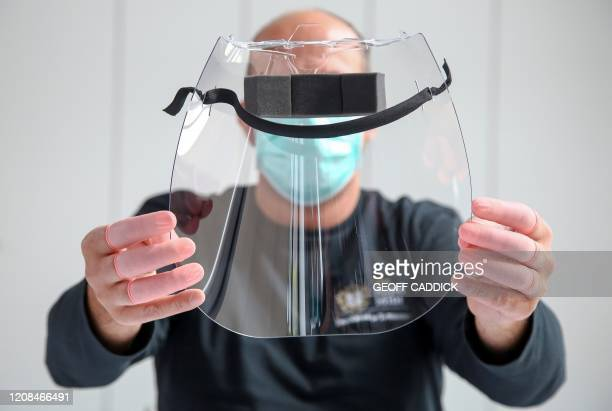 An employee at the Royal Mint is pictured during a media opportunity as they work on the production of a medical visor at the company's plant in...