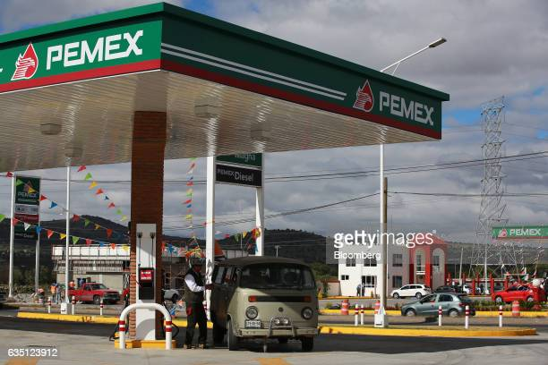 An employee attends to a vehicle at a Petroleos Mexicanos gas station near Mexico City Mexico on Wednesday Dec 28 2016 The gasoline price hike which...