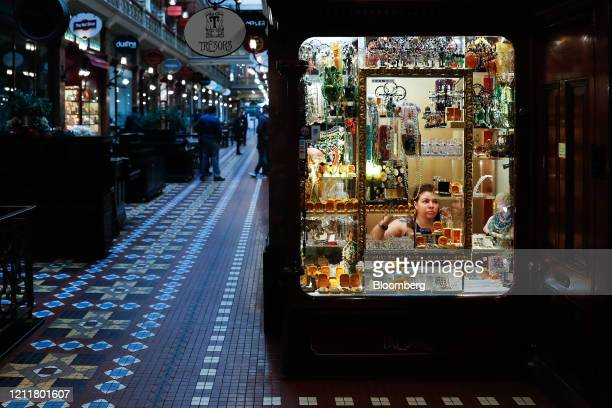 An employee attends to the window display of a jewelry store at a nearempty Strand Arcade during a partial lockdown imposed due to the coronavirus in...