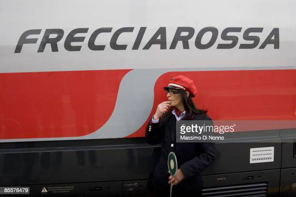 An employee blows a whistle as Frecciarossa makes its maiden journey on the new high speed link between Milan and Rome on March 24 2009 in Milan...