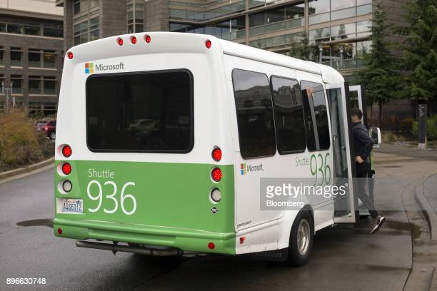 An employee boards a shuttle on the Microsoft Corp main campus in Redmond Washington US on Tuesday Dec 19 2017 In the race to commercialize a new...