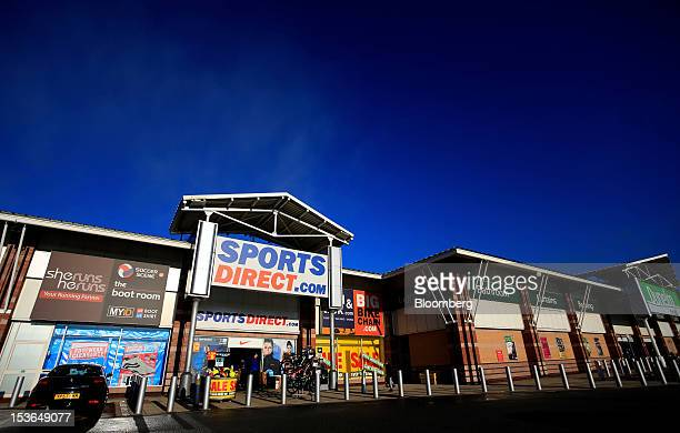 An employee carries out a boxed bicycle for display ahead of opening at a Sports Direct International Plc store in Urmston UK on Saturday Oct 6 2012...