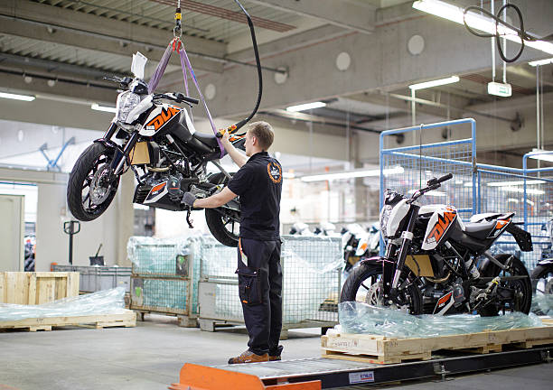 An employee performs a final quality check on a completed KTM 125 Duke motorcycle model inside the KTM-Sportmotorcycle AG motorcycle manufacture ...