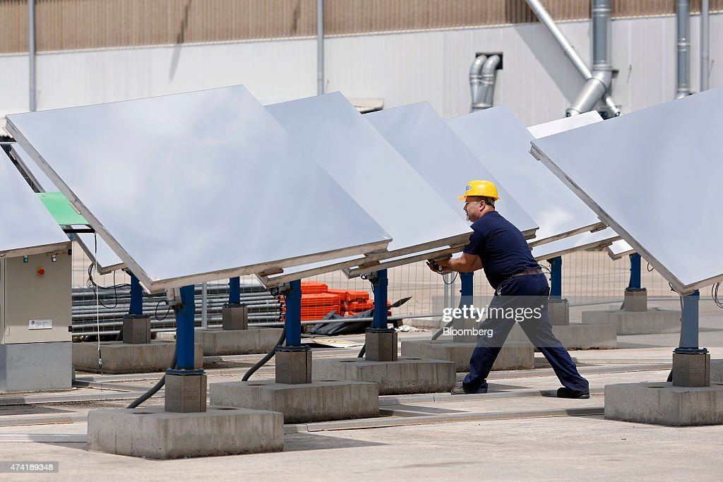 An employee carries out maintenance work on heliostat panels at a Solar Thermoelectric Magaldi (STEM) pilot plant, operated by Magaldi Group, in Buccino, Italy, on Monday, May 18, 2015. The project captures the energy of the sun which is transferred via the generation unit to heat retaining silica sand, producing steam that powers a turbine and is suitable for use in systems operating over a large temperature range. Photographer: Alessia Pierdomenico/Bloomberg via Getty Images