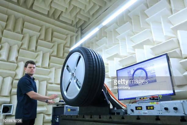 An employee carries out vibration tests on an automobile wheel hub inside an anechoic sound chamber at the Schaeffler AG factory in Herzogenaurach...